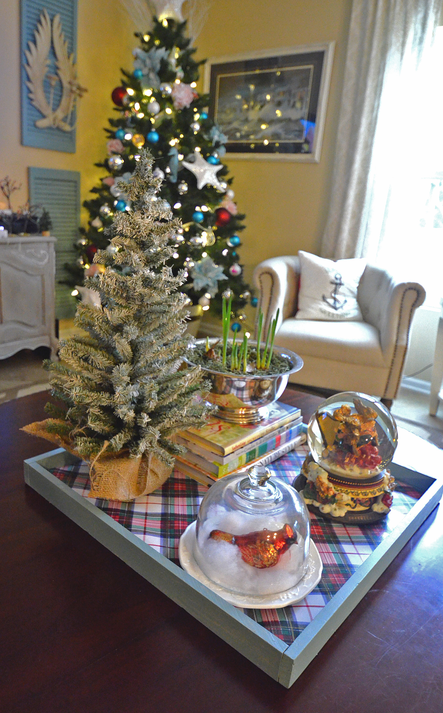slightly coastal christmas living room coffee table