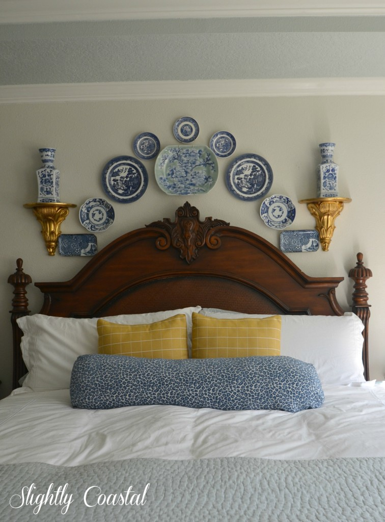 blue-and-white-plates-above-bed-for-a-coastal-feel-756x1024